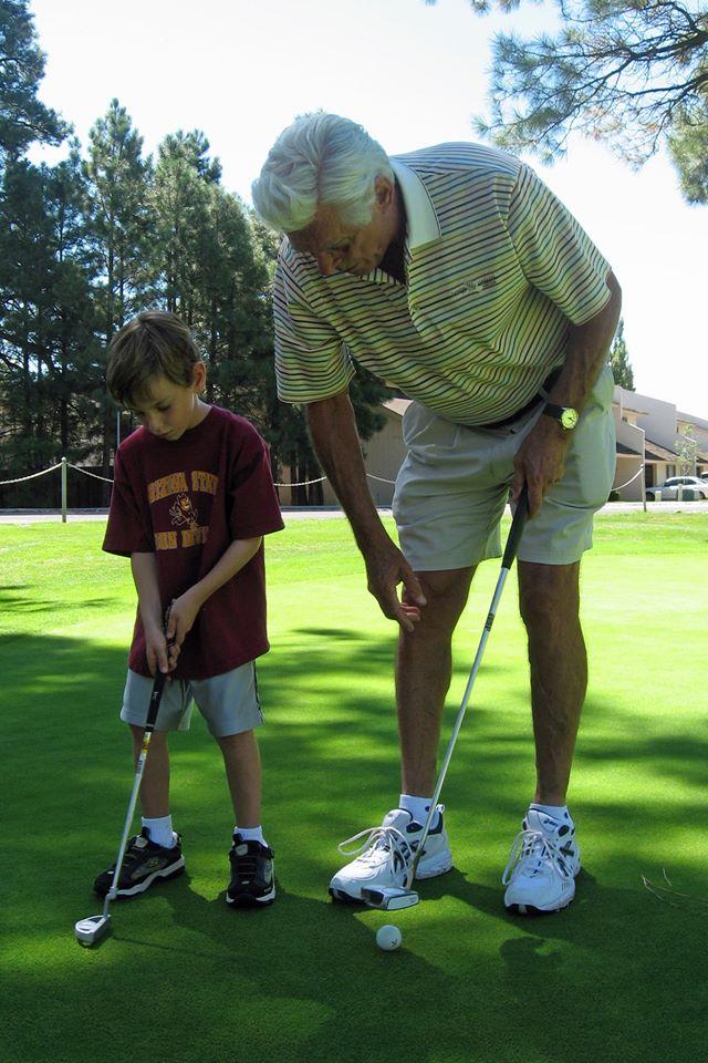Grandpa and Grandson Golfing