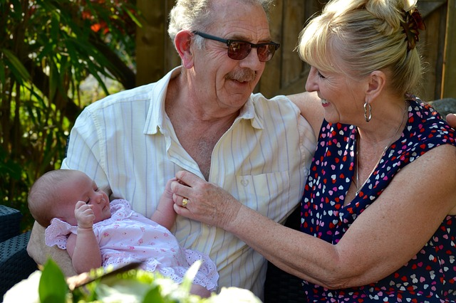 modern grandparents with baby